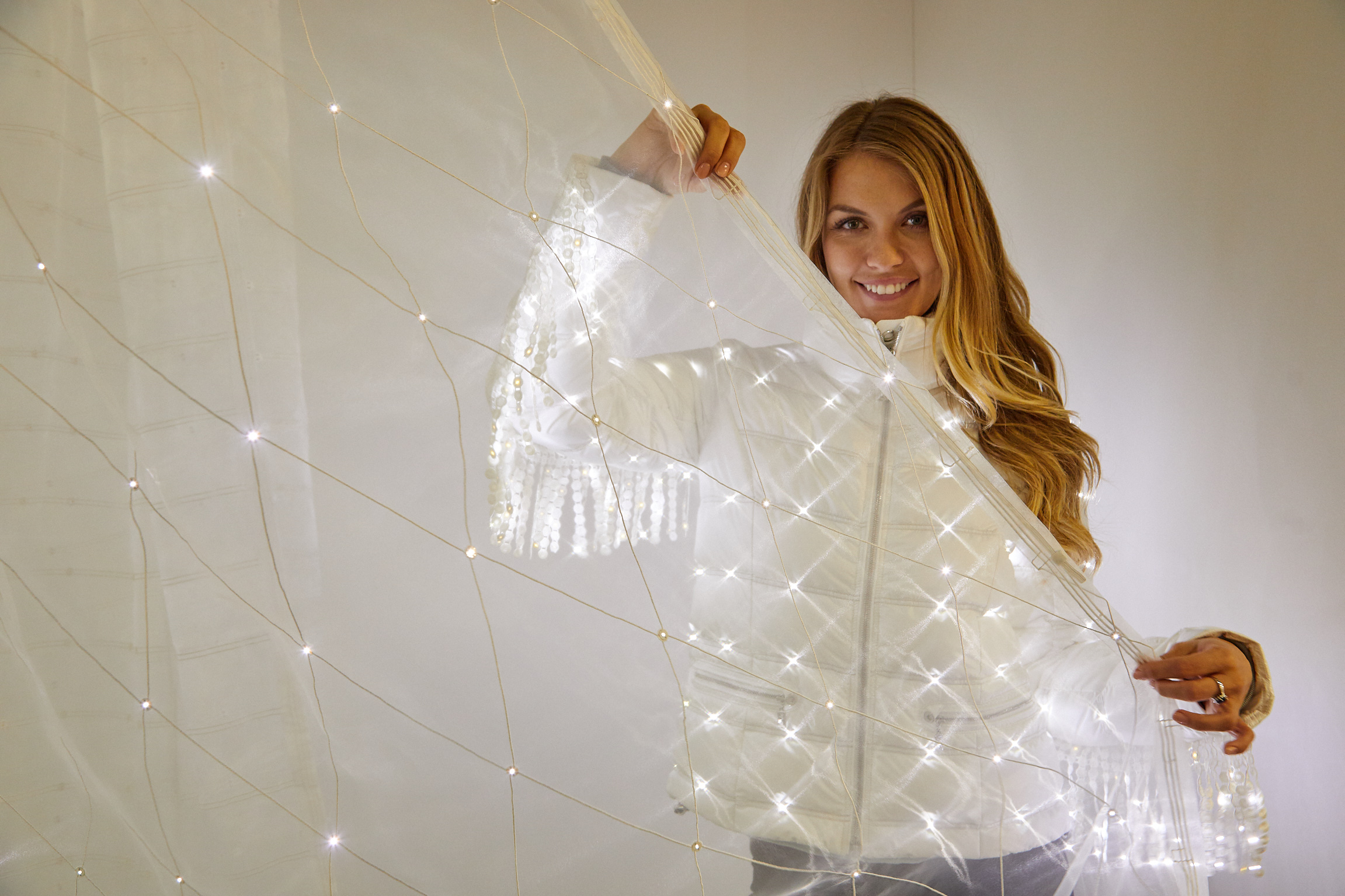 Après-Ski Jacket and LED-Curtain: E-Broidery with LED-Textiles: the E-Boidery Technology allows the integration of active lighting into fabrics without compromising washability and drapability